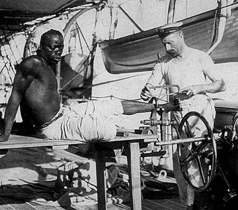 slaveshacklebeingremovedbybritishsailor1907